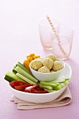 Raw vegetable sticks with cream cheese balls