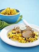 Spicy saffron rice with pork fillet and yoghurt