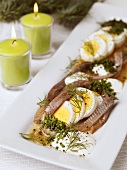 Anchovies & herrings with egg & sour cream (Scandinavia)