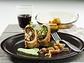 Chicken roulade with ham and herb filling, roast potatoes