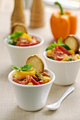 Piperade (pepper dish) with toast in small pots