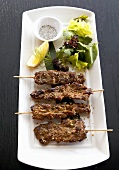 Beef skewers with lemon grass and salad