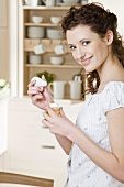 Young woman putting salt on boiled egg