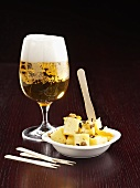 Diced cheese with beer