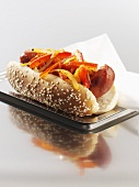 Hot dog with red pepper in sesame bun