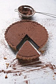 Chocolate tart dusted with cocoa powder