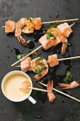 Salmon and prawn skewers with orange sabayon