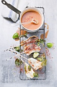 Sole saltimbocca with tomato and coconut sauce
