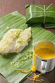 Pangasius in banana leaf and saffron sauce