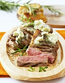 Grilled rump steak with garlic and herb butter