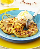 Grilled pineapple slices with pink pepper & vanilla ice cream