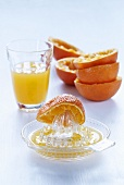 Citrus squeezer, orange halves & freshly squeezed orange juice