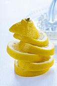Stacked lemon slices, lemon squeezer in background