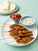 Tandoori chicken kebabs with yoghurt dip, tomatoes, flatbread