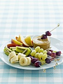 Fruit kebabs with caramel sauce