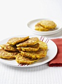 Several corn cakes on plate