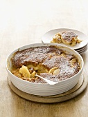 Apple pudding sprinkled with icing sugar