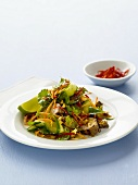 Asian-style vegetable salad with pork