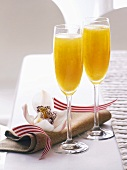 Two Bellinis (cocktail made with sparkling wine)