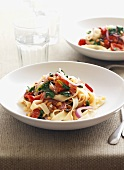 Ribbon pasta with tomatoes, spinach and pine nuts