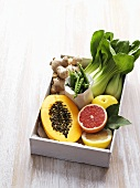 Box of fresh exotic fruit and vegetables