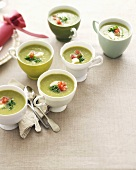 Cold green asparagus soup in cups