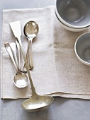 Spoons, ladle and soup bowls
