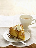 A piece of pineapple honey cake with a cup of tea