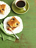 Two pieces of plum cake with a cup of coffee