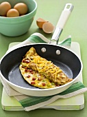 Cheese omelette in frying pan