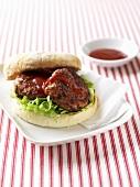 Lamb burger with ketchup