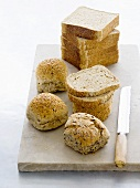 White sliced bread, sesame bread and granary rolls