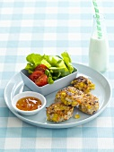 Chicken and sweetcorn cakes with salad and chilli sauce
