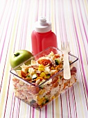 Farfalle with tuna and vegetables, apple, drinking bottle