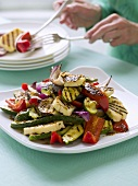 Grilled vegetables, person in background