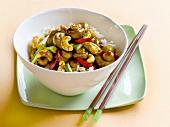 Button mushroom and cashew stir-fry on rice