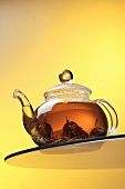 Ceylon tea in glass teapot