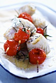 Grilled halibut rolls with tomatoes