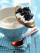 Bread with soft cheese & blackberry & elderberry jam on cup