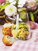 Scrambled egg and young spinach in glass for Easter