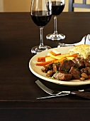 Braised beef in red wine sauce with root vegetables