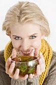 Blond woman drinking herbal tea