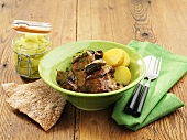 Braised ribs with potatoes and cucumber salad in jar