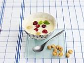 Lemon soup with raspberries and amaretti