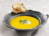 Cream of carrot soup with herb quark