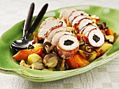 Chicken breast rolls with plum stuffing on vegetables