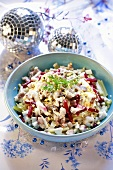 Herring salad in a pale blue bowl & two mirrored baubles