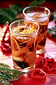 Fruit compote with lemon zest in small glasses (Christmas)