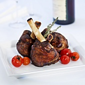 Legs of lamb with cherry tomatoes