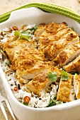 Chicken breasts with yoghurt curry sauce on rice